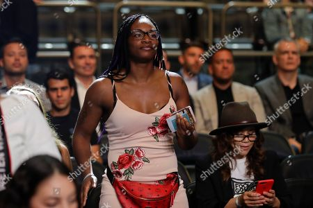 Claressa Shields waits for the start of a women's lightweight championship boxing match between Ireland's Katie Taylor and Delfine Persoon, of Belgium, in New York. The fight ended in a draw. Taylor won the fight