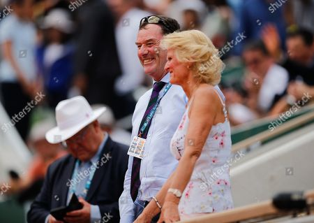 Philip Brook, Chairman of The All England Lawn and Tennis Club, with his wife Gill Brook smile as they watch Johanna Konta of Great Britain defeat Sloane Stephens in straight sets in the quarter-finals