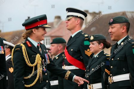 Julie Payette, Canada's General Governor, left, reviews troops during a French-Canadian ceremony to commemorate the Poche de Falaise battle in Chambois, Normandy, . France is preparing to mark the 75th anniversary of the D-Day invasion which took place on June 6, 1944