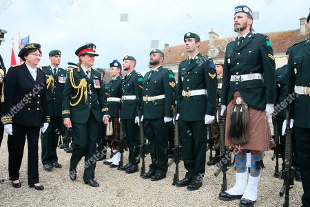 Julie Payette, Canada's General Governor, second left, reviews troops during a French-Canadian ceremony to commemorate the Poche de Falaise battle in Chambois, Normandy, . France is preparing to mark the 75th anniversary of the D-Day invasion which took place on June 6, 1944