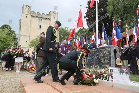 Julie Payette, Canada's General Governor, centre, lays a wreath after unveiling a plaque in tribute to fallen Canadian soldiers during a French-Canadian ceremony to commemorate the Poche de Falaise battle in Chambois, Normandy, . France is preparing to mark the 75th anniversary of the D-Day invasion which took place on June 6, 1944