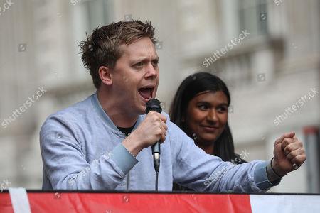 Owen Jones, Labour Party activist and journalist and Ash Sarkar speak at a demonstration on Whitehall