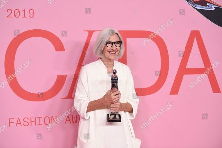 Eileen Fisher poses with the positive change award at the CFDA Fashion Awards at the Brooklyn Museum, in New York