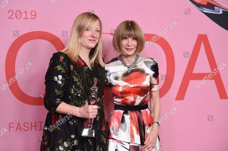 Sarah Burton, Anna Wintour. Honoree Sarah Burton, left, poses in the winner's walk with the Valentino Garavani and Giancarlo Giammetti international award with Anna Wintour at the CFDA Fashion Awards at the Brooklyn Museum, in New York