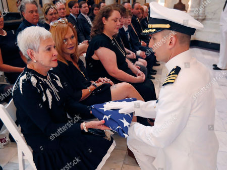 Kay Webber Cochran, John-Paul Falardeau. Navy Cmdr. John-Paul Falardeau from Naval Air Station-Meridian, right, presents the American flag that was draped on the coffin of the late Republican senator Thad Cochran, to his widow, Kay Webber Cochran at the Mississippi State Capitol in Jackson, Miss., . Cochran was 81 when he died Thursday in a veterans' nursing home in Oxford, Mississippi. He was the 10th longest serving senator