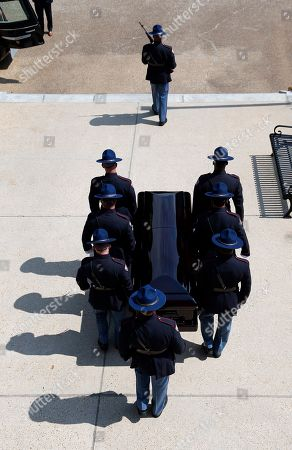 A Mississippi Highway Patrol Honor Guard, escorts the coffin of the late Republican senator Thad Cochran, from the Mississippi State Capitol in Jackson, Miss., . Cochran was 81 when he died Thursday in a veterans' nursing home in Oxford, Mississippi. He was the 10th longest serving senator