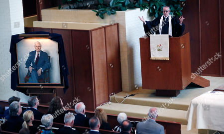 Pastor Charles Poole speaks during the funeral service for the late Republican senator Thad Cochran, at Northminster Baptist Church in Jackson, Miss., . Cochran was 81 when he died Thursday in a veterans' nursing home in Oxford, Mississippi. He was the 10th longest serving senator