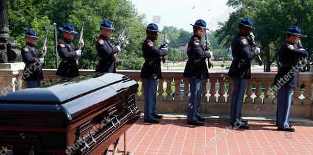 Stock Image of Mississippi Highway Patrol honor guard fire a 21-gun salute in honor of the late Republican senator Thad Cochran, as his casket is taken from the Mississippi State Capitol in Jackson, Miss., . Cochran was 81 when he died Thursday in a veterans' nursing home in Oxford, Mississippi. He was the 10th longest serving senator