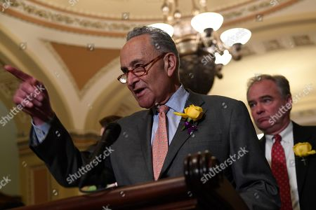 Chuck Schumer, Tim Kaine. Senate Minority Leader Sen. Chuck Schumer of N.Y., speaks to reporters following the weekly policy lunches on Capitol Hill in Washington, . Sen. Tim Kaine, D-Va., listens at right