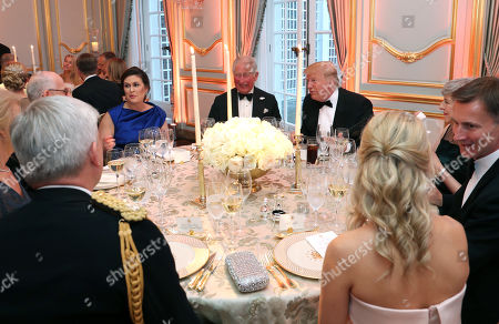 US President Donald Trump (R) and First Lady Melania Trump host a dinner at Winfield House for Prince Charles (C) and Camilla Duchess of Cornwall, with White House Press Secretary Sarah Huckabee Sanders (L) during the state visit