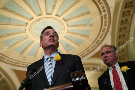Mark Warner, Tim Kaine. Sen. Mark Warner, D-Va., left, speaks to reporters about the shooting at Virginia Beach, Va., following the weekly policy lunches on Capitol Hill in Washington, . Sen. Tim Kaine, D-Va., listens at right
