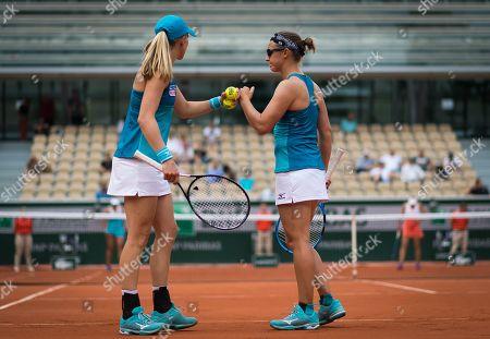 Stock Picture of Johanna Larsson of Sweden & Kirsten Flipkens of Belgium playing doubles at the 2019 Roland Garros Grand Slam tennis tournament