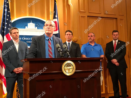 Roger Beedon discusses how sexual misconduct by now-deceased Ohio State team doctor Richard Strauss has affected his life, during a news conference with fellow Strauss accusers, from left, Brian Garrett, Dan Ritchie and Mike Flusche, and state Rep. Brett Hillyer, at the Statehouse in Columbus, Ohio. They were speaking in support of a bill that would give Strauss accusers a legal opportunity to sue the university over the alleged abuse decades ago