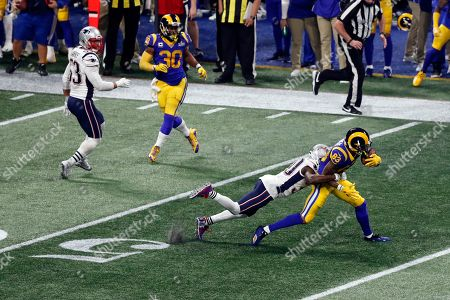 Stock Photo of Los Angeles Rams' Josh Reynolds (83) is tackled by New England Patriots' Jason McCourty (30) during the NFL Super Bowl 53 football game, in Atlanta. The Patriots won 13-3