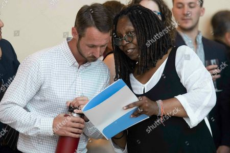 """Whoopi Goldberg, Andrew Cooper. Actress Whoopi Goldberg speaks to 4Ocean founder Andrew Cooper during the opening of the """"Planet or Plastic?"""" exhibit, at United Nations headquarters"""