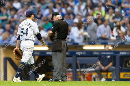 Stock Image of Milwaukee Brewers relief pitcher Taylor Williams #54 exists the game in the 5th inning. Taylor pitch 1/3 of an inning giving up 8 earned runs in the Major League Baseball game between the Milwaukee Brewers and the Miami Marlins at Miller Park in Milwaukee, WI