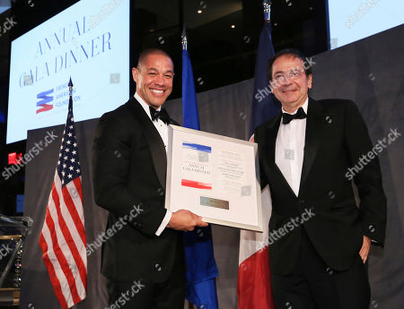 Master of Ceremonies Michael Morales, left, honors John Paulson, President of Paulson & Co. Inc., right, for exemplary leadership at the French-American Foundation Annual Gala Dinner, in New York