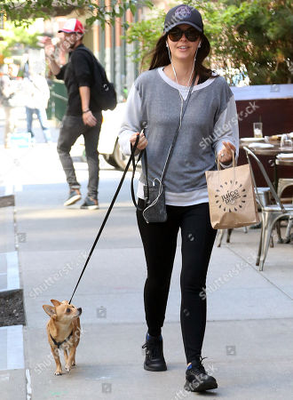 Stock Image of Katie Lee Joel and her dog Gus