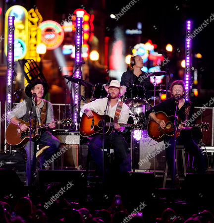 Cody Johnson, Kix Brooks, Ronnie Dunn. Cody Johnson, center, performs with Kix Brooks, left, and Ronnie Dunn, right, during the CMT Cross Roads Brooks & Dunn and Friends live taping on Broadway, in Nashville, Tenn