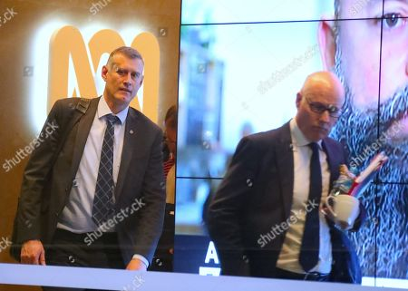 John Lyons (R), Executive Editor of ABC News, is followed by an Australian Federal Police officer as they walk out the main entrance to the ABC building located at Ultimo in Sydney, New South Wales, Australia, 05 June 2019. Federal police officers have raided ABC's Sydney offices over a series of stories published in 2017, known as 'The Afghan Files', that suggested Australian troops may have committed war crimes.