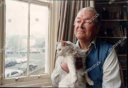 Author Kingsley Amis (1922-1995) At Home With His Cat.