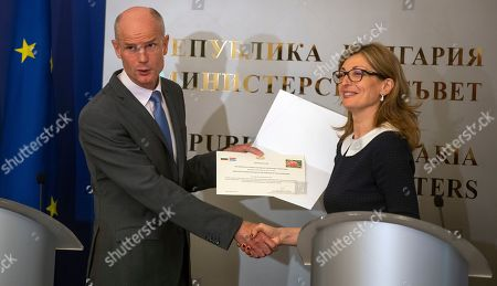 Dutch Foreign Affairs Minister Stef Blok (L) receives a certificate from Bulgarian Foreign Minister Ekaterina Zaharieva (R), in Sofia, Bulgaria, 05 June 2019. Blok is on a two-day official visit to Bulgaria. The certificate reads that some 110 Bulgarian 'Damascena' roses will be delivered in the autumn of 2019 to the Dutch Ministry in the Netherlands to celebrate the 110th anniversary of the establishment of diplomatic relationship between the two countries.