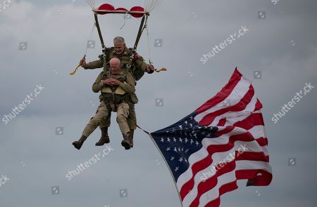 US WWII 101st Airborne paratrooper veteran, Tom Rice, 97, executes a commemorative tandem parachute jump over the town of Carentan  near the Normandy coast ahead of the 75th D-Day anniversary, in Carentan,  France, 05 June 2019. On 06 June 1944 in the Second World War, the allied forces invaded northern France by means of beach landings in Normandy.