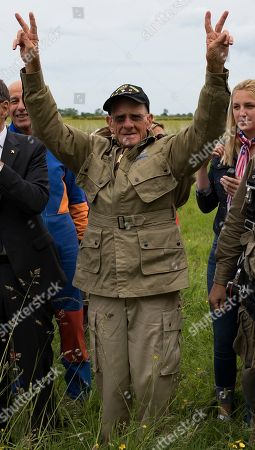 US WWII 101st Airborne paratrooper veteran, Tom Rice, 97, waves after completing a commemorative tandem parachute jump over the town of Carentan  near the Normandy coast ahead of the 75th D-Day anniversary, in Carentan,  France, 05 June 2019. On 06 June 1944 in the Second World War, the allied forces invaded northern France by means of beach landings in Normandy.
