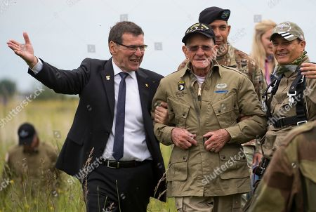 US WWII 101st Airborne paratrooper veteran, Tom Rice, 97, is escorted by mayor of Carentan Jean-Pierre Lhonneur after completing a commemorative tandem parachute jump over the town of Carentan  near the Normandy coast ahead of the 75th D-Day anniversary, in Carentan,  France, 05 June 2019. On 06 June 1944 in the Second World War, the allied forces invaded northern France by means of beach landings in Normandy.
