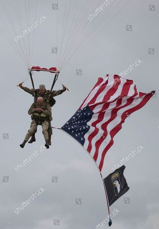 US WWII 101st Airborne paratrooper veteran, Tom Rice, 97, executes a commemorative tandem parachute jump over the town of Carentan  near the Normandy coast ahead of the 75th D-Day anniversary, in Carentan,  France, 05 June 2019. World leaders are to attend memorial events in Normandy, France on 06 June 2019 to mark the 75th anniversary of the D-Day landings, which marked the beginning of the end of World War II in Europe.