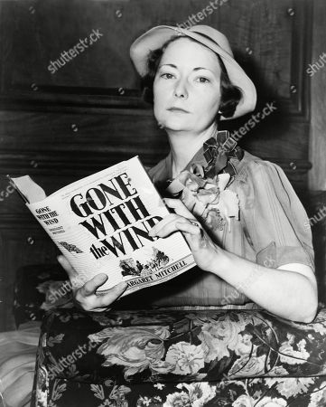 Stock Picture of Margaret Mitchell (1900-1949), holding her novel, Gone with the Wind, the 1937 winner of the Pulitzer Prize. She received $50,000 for the rights to make the classic Hollywood movie starring Clark Gable and Vivian Leigh.