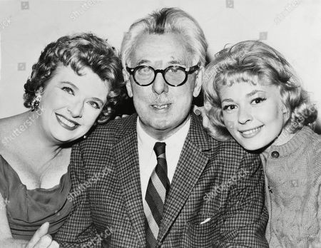 James Thurber (1894-1961) American humorist, cartoonist and editor of the New Yorker, with actress Peggy Cass (on left) and author Joan Anderson. 1960.