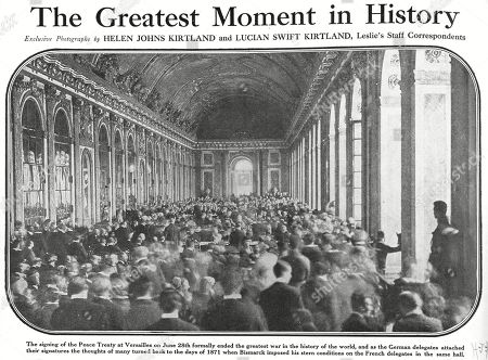 Stock Image of World War I, signing the peace treaty to end the war. The original headline reads: The greatest moment in history, / exclusive photographs by Helen Johns Kirtland and Lucian Swift Kirtland, Leslies Staff Correspondents. Versailles, June 28, 1919.