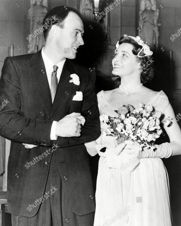 Patricia Neal (b. 1926) and Roald Dahl (1916-1990), smiling at each after their wedding in 1953.