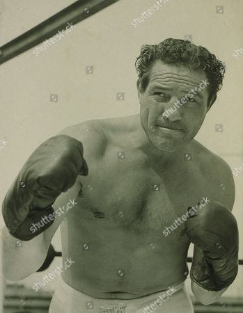 Stock Photo of Max Baer (1909-1959), one-time Heavyweight Champion of the World, also worked as an actor, wrestler, and referee. THE PRIZEFIGHTER AND THE LADY of 1933 was the first of his 20 film performances. His son Max Baer Jr. is best known for his role as Jethro of the BEVERLY HILLBILLIES.