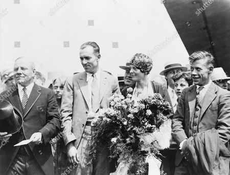 Mayor Malcolm Nichols, greets flyers Lou Gordon, Amelia Earhart, and Wilmer Stultz, as they arrived in Boston, Massachusetts, following trans-Atlantic flight in 1928. A crowd of 300,000 turned out to celebrate the flyers.