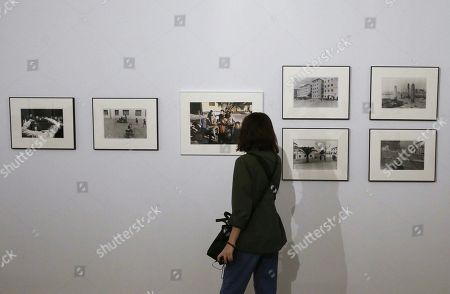 A visitor looks at photographs by US photographer Joel Meyerowitz on display during the exhibition 'Into the Light', in Madrid, Spain, 06 June 2019. The event features 98 photographs showing the social, cultural and political situation in Spain from 1966 to 1967 will be open to public from 05 June to 31 July 2019.