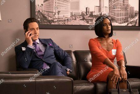 Stock Image of Scott Cohen as Ezra Wolf and Skye P. Marshall as Angela Ashley