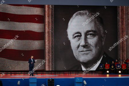 President Donald Trump speaks during a ceremony to mark the 75th Anniversary of D-Day, when the Allied soldiers, sailors and airmen conducted an invasion that helped liberate Europe from Nazi Germany, in Portsmouth, England. An image of President Franklin D. Roosevelt is shown, right