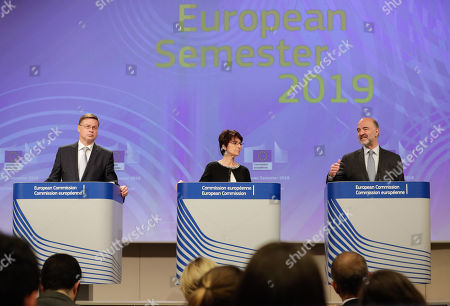 EU Commission Vice-President for Financial Services and Capital Markets Union, Valdis Dombrovskis (L), European Commissioner for Employment, Social Affairs, Skills and Labour Mobility Marianne Thyssen and European Commissioner for Economic and Financial Affairs, Taxation and Customs Pierre Moscovici (R) give a press conference on the European Semester Spring 2019 package at the European Commission in Brussels, Belgium, 5 June 2019. The European Commission recommended disciplinary proceedings against Italy because the country was breaking fiscal rules over its rising public debt.