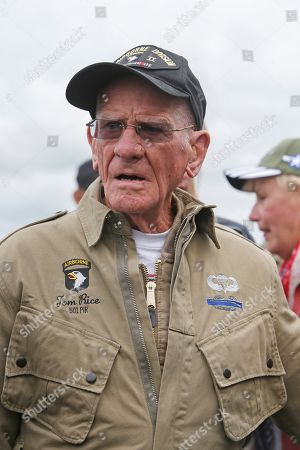 U.S. World War II D-Day veteran Tom Rice, from Coronado, CA, speaks after parachuting in a tandem jump into a field in Carentan, Normandy, France, . Approximately 200 parachutists participated in the jump over Normandy on Wednesday, replicating a jump made by U.S. soldiers on June 6, 1944 as a prelude to the seaborne invasions on D-Day