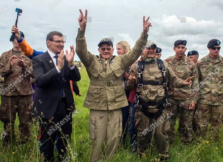 U.S. World War II D-Day veteran Tom Rice, from Coronado, CA, after parachuting in a tandem jump into a field in Carentan, Normandy, France, . Approximately 200 parachutists participated in the jump over Normandy on Wednesday, replicating a jump made by U.S. soldiers on June 6, 1944 as a prelude to the seaborne invasions on D-Day