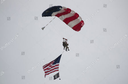 U.S. World War II D-Day veteran Tom Rice, from Coronado, CA, parachutes in a tandem jump into a field in Carentan, Normandy, France, . Approximately 200 parachutists participated in the jump over Normandy on Wednesday, replicating a jump made by U.S. soldiers on June 6, 1944 as a prelude to the seaborne invasions on D-Day