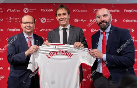 Sevilla FC's new head coach, Julen Lopetegui (C), poses with the President of Sevilla FC, Jose Castro (L) , and Sports Director, Ramon Rodriguez 'Monchi', during his presentation in Seville, Spain, 05 June 2019. Lopetegui has signed a three-year-contract with the LaLiga club.