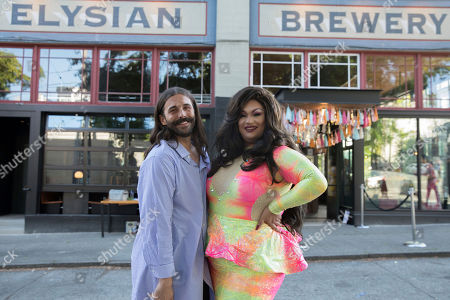 Jonathan Van Ness (left) poses with Ada Vox (right) at the #MarryUsJVN Wedding at Elysian Brewing's Capitol Hill brewpub, in Seattle
