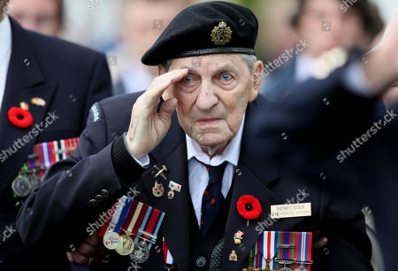 Canadian World War II veteran Sidney Cole salutes as he attends a ceremony at the Beny-sur-Mer Canadian War Cemetery in Reviers, Normandy, France,. A ceremony was held on Wednesday for Canadians who fought and died on the beaches and in the bitter bridgehead battles of Normandy during World War II