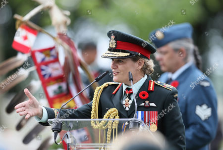 Julie Payette, Governor General of Canada and Commander-in-Chief of the Canadian Armed Forces speaks during a ceremony at the Beny-sur-Mer Canadian War Cemetery in Reviers, Normandy, France,. A ceremony was held on Wednesday for Canadians who fought and died on the beaches and in the bitter bridgehead battles of Normandy during World War II