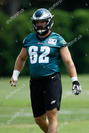 Philadelphia Eagles' Jason Kelce walks the field during organized team activities at the NFL football team's practice facility, in Philadelphia