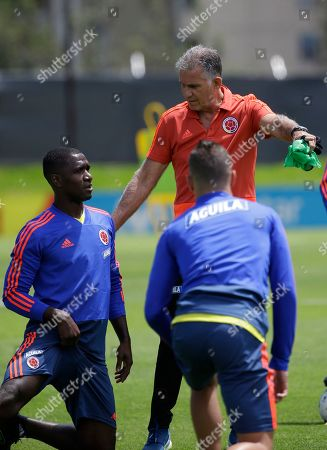Carlos Queiroz, Cristian Zapata. Colombia's national soccer coach Carlos Queiroz, top right, talks to Cristian Zapata, left, during a training session of the national soccer team in Bogota, Colombia, . Colombia will play a friendly match against Peru on June 9