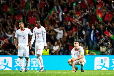 Swiss players (L-R) Manuel Akanji, Edimilson Fernandes, and Granit Xhaka react during the UEFA Nations League semi final soccer match between Portugal and Switzerland at the Dragao stadium in Porto, Portugal, 05 June 2019. Portugal won 3-1.